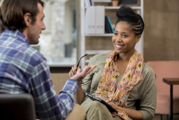 Caucasian counseling patient talks with counselor