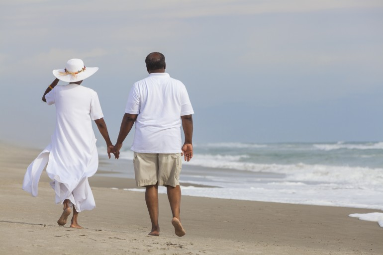 Happy Senior African American Couple Man Woman on Beach